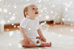 Happy baby with soap bubbles at home Royalty Free Stock Photos