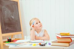 Childhood and back to school concept. Girl with thoughtful face expression royalty free stock photos