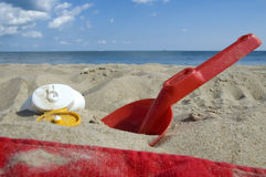 Childhood. beach items and sun Royalty Free Stock Photo