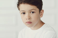 Childhood. Boy in white shirt Royalty Free Stock Images