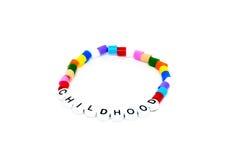 Childhood bracelet on white Stock Images