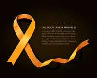 Childhood cancer awareness. Concept ribbon - gold vector ribbon with space for your text isolated on dark background Stock Photo