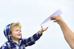 Childhood. Child son playing with paper airplane. Carefree. Freedom to Dream - Joyful Boy Playing With Paper Airplane. royalty free stock photos