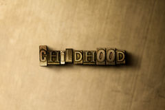 CHILDHOOD - close-up of grungy vintage typeset word on metal backdrop. Royalty free stock illustration.  Can be used for online banner ads and direct mail Stock Photo