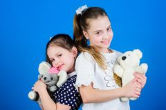 Childhood concept. Kids adorable cute girls play with soft toys. Happy childhood. Child care. Excellence in early stock photos