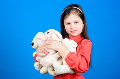 Childhood concept. Small girl smiling face with toys. Happy childhood. Little girl play with soft toy teddy bear. Lot of royalty free stock images