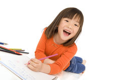 Childhood Drawing. A young asian girl drawing a picture. On white Stock Photos