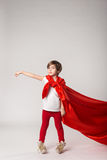 Childhood dream, kid pretend superwoman Royalty Free Stock Images