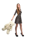 Childhood dreams. Young lady with teddy bear on white background Royalty Free Stock Photos