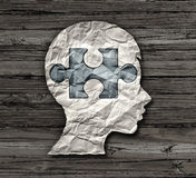Childhood Education. Or mental disorder in the brain of a child as epilepsy add or adhd or autism symbol as a crumpled paper with a puzzle piece shaped as the Royalty Free Stock Photo