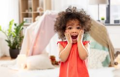 Surprised or scared little african american girl. Childhood, expressions and emotions concept - surprised or scared little african american girl screaming over royalty free stock images