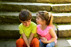 Childhood first love. summer holiday vacation. small girl and boy on stair. Relations. couple of little children. Boy. And girl. best friends, friendship and stock image