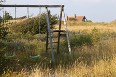 Childhood Freedom. No fences hem the children in in this landscape of wild grasses and coastal terrain. Summer is in full swing and the rural landscape is Stock Photos