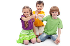 Childhood friends. Collaboration concept - kids showing thumbs up sign Stock Photography