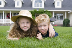 Childhood friends. A brother and sister laying in the grass Royalty Free Stock Photo