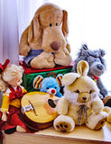 Childhood friends - favorite toys. The toys loved in the childhood remain a pleasant nmemories for adults Stock Image