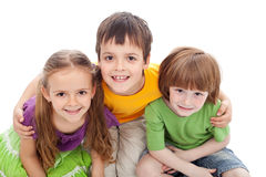 Childhood friends portrait. Kids bracing each other, isolated Stock Image