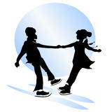 Childhood friendship. figure skating. Children silhouettes. boy and girl dancing on ice Stock Photos