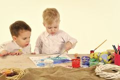 Childhood, friendship, small boy kids paint handmade egg. Childhood and friendship of small boys paint eggs Royalty Free Stock Image