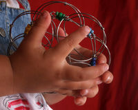 Childhood Game. Child hands figuring out a childhood puzzle Royalty Free Stock Image