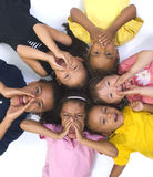 Childhood Girls. Young kids growing up and having fun. Childhood, learning, exploration family Stock Image
