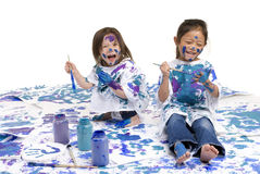 Childhood Girls floor painting. Two young girls having fun painting everything. Childhood, learning, exploration family Stock Image