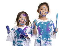 Childhood Girls floor painting. Two young girls having fun painting everything. Childhood, learning, exploration family Stock Photos