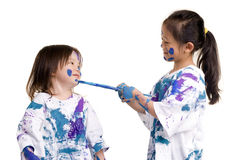 Childhood Girls floor painting. Two young girls having fun painting everything. Childhood, learning, exploration family Royalty Free Stock Photos
