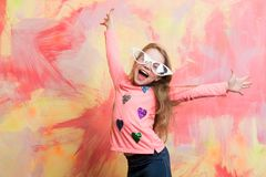 Childhood and happiness. Child girl on colorful background. glasses on girl kid with happy face. Small girl in fashionable summer glasses. beauty and fashion Royalty Free Stock Photography