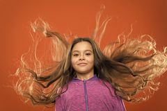 Childhood happiness. Family. Kid fashion and sportswear. Happy little girl with long hair. childrens day. Portrait of. Happy little child. Small girl child royalty free stock photos
