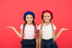 Childhood happiness. Friendship and sisterhood. small kid fashion. childrens day. Back to school. small girl children. With perfect hair. Happy little sisters stock images