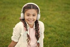 Childhood happiness. Mp3 player. small kid listen ebook, education. childrens day. Audio technology. small girl child in royalty free stock photography