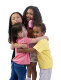 Childhood kids. Four young kids having fun and growing up. Childhood, learning, exploration family Stock Photo