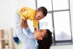 Happy african american mother with baby at home royalty free stock images