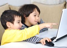Childhood, laptop, learning Stock Image