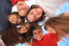 Childhood Laughter Among Friends. Six Kids Laughing Outdoors in the Sunshine Royalty Free Stock Photo