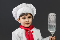 Childhood, Little boy preparing healthy food on kitchen over gre Stock Images