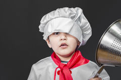 Childhood, Little boy preparing healthy food on kitchen over gre Royalty Free Stock Photos