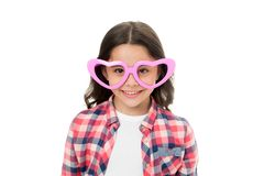 Childhood love concept. Child charming smile fall in love. Girl heart shaped eyeglasses celebrates valentines day. Girl. Cute kid smiling face heart eyeglasses stock photos