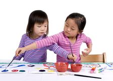 Childhood Painting 008. A young girl paints her masterpiece with bright colors Stock Image