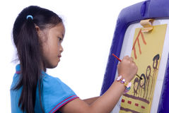 Childhood Painting. A young girl paints a picture. Family, love, bonding, education Stock Photography