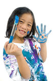 Childhood Painting. A young asian girl having fun painting her hands Stock Images