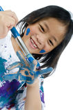 Childhood Painting. A young asian girl having fun painting her hands Royalty Free Stock Photo