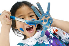 Childhood Painting. A young asian girl having fun painting her hands Stock Photography