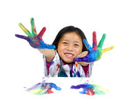 Childhood Painting. A young asian girl having fun painting her hands Royalty Free Stock Photography