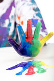 Childhood Painting. A child having fun painting hands in bright colors Royalty Free Stock Photo