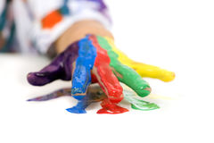 Childhood Painting. A young asian girl having fun painting her hands Royalty Free Stock Photos