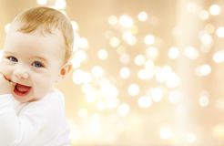 Close up of sweet baby over christmas lights stock photos