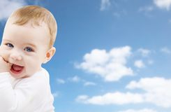 Close up of sweet little baby over sky background stock image