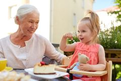 Little girl with grandmother eating cafe Royalty Free Stock Photos